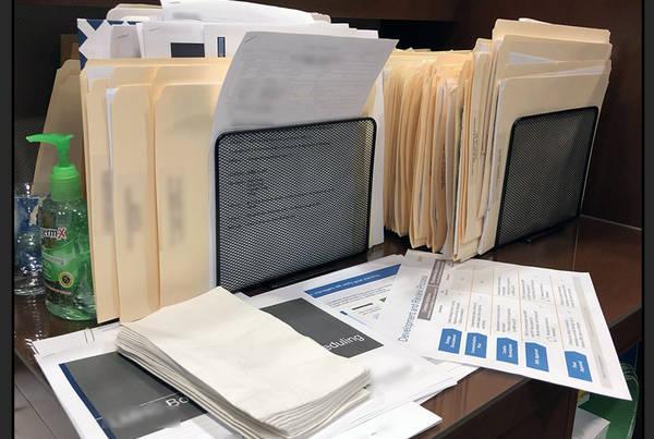 Confidential Paperwork on Desk